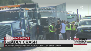 An Alligator Alley crash killed two men.  Click on the image to watch the video of the WINK report.